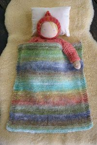 Knitted doll blanket pattern. Sure it's the rainbow effect that has caught my eye. And that waldorf doll with it's snuggly hood is divine x