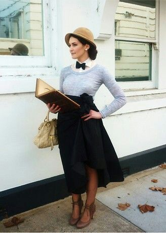 Now listen. I have to read this book. And stand in the wind. And rock this sweater/bow tie/vintage hat. And show off my legs. Could you grab me something to eat? Thank you.