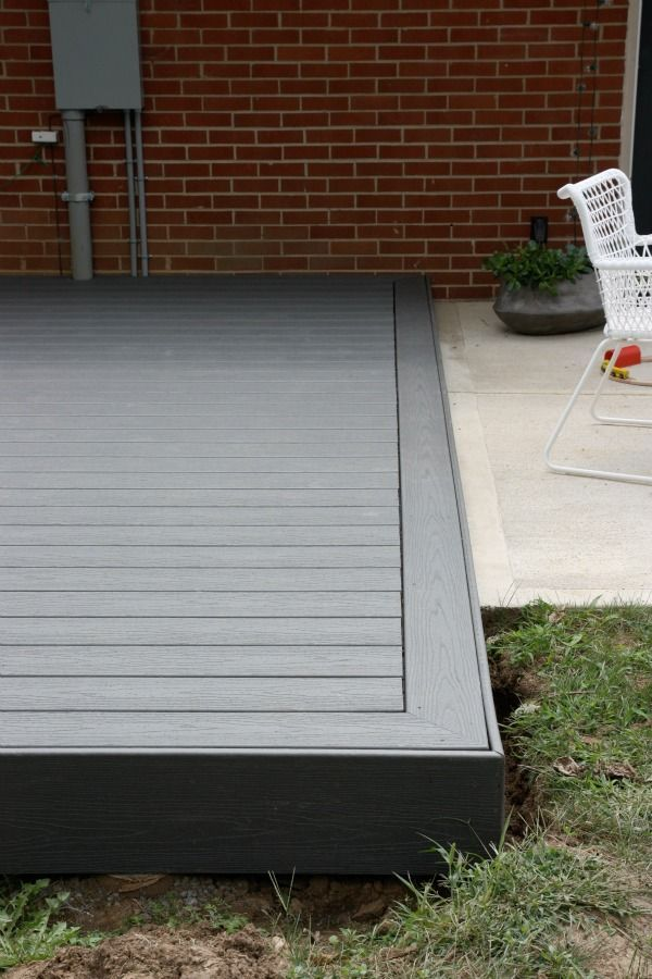 Photo 7- grey Trex type decking material. See small screw holes in large image (Patio Step Bifold)