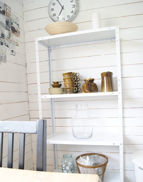 white painted wall and light brown objects
