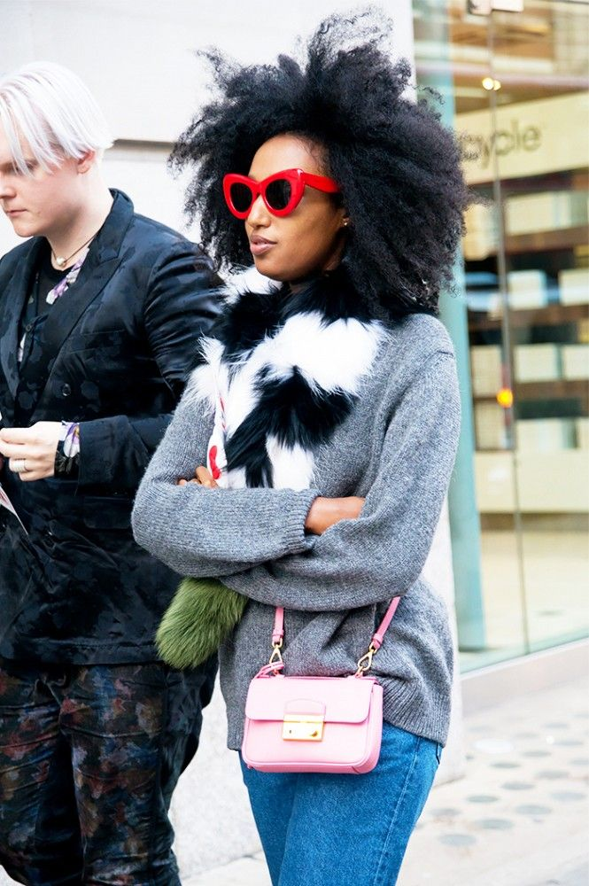 Julia Sarr-Jamois's bold wardrobe never disappoints. Here, she rocks red sunnies and a colorblock fur scarf.