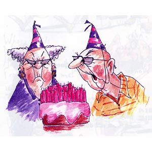 Old couple with party hats blowing out candles on cake