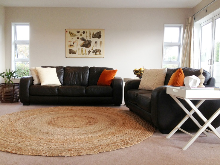 Leather couches can be over-bearing. Soften with cushions and Madras round rug #Freedomfurniture.