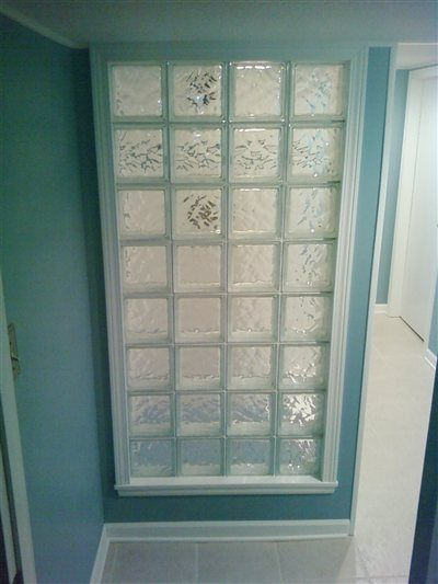 A basement bathroom idea - glass block wall to make bathroom look bigger and let in light while still keeping privacy?