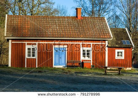 Ronneby, Sweden - January 7, 2018: Documentary of everyday life and environment. Old, traditional Swedish wooden homestead, often found in woodland areas. Red house with white and blue details.