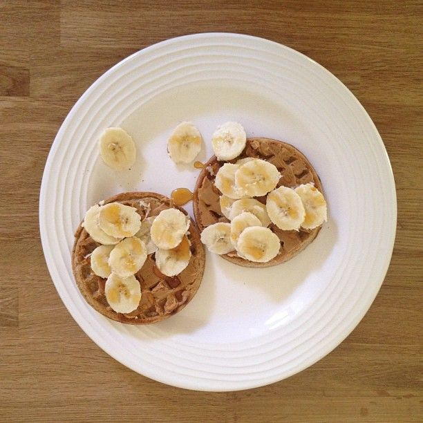 whole wheat waffles with peanut butter and bananas drizzled with honey