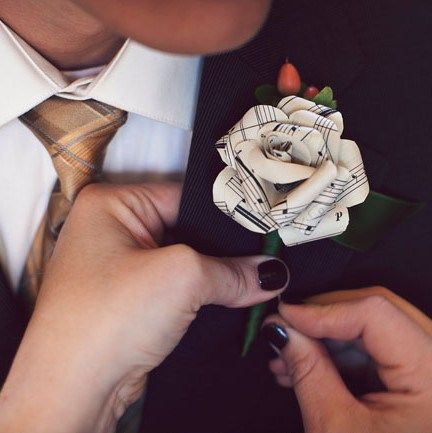 sheet music roses as boutonnieres for groom and best man then the rest w felt balls and hearts