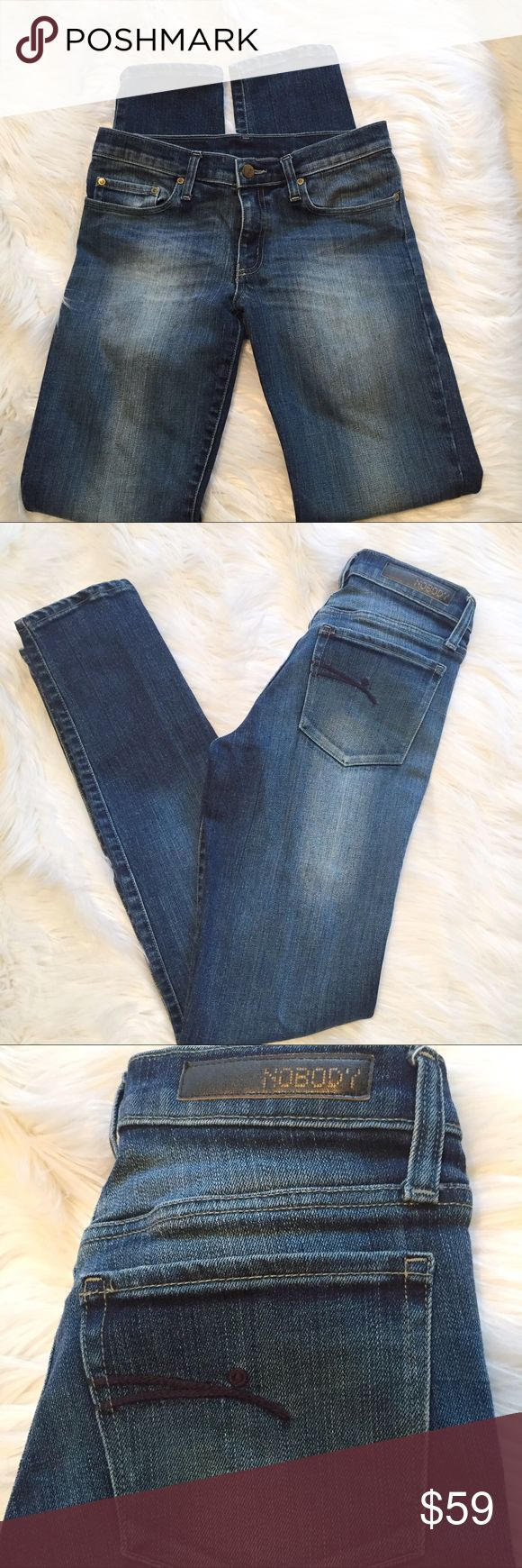 """Nobody Denim dark wash Midrise skinny jeans 28 x33 These photographed a bit lighter than they appear in person. Lovely Japanese Denim made in Australia- good condition weight and yet soft to the touch. Midrise skinny cut. 2% elastane. Size 28. 30"""" waist. 8"""" rise. 12.5"""" rear rise. 9.5"""" thigh measured flat. 33"""" inseam. Nobody Jeans Skinny"""