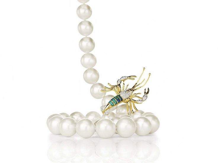Australian pearl strand pictured with a unique Lobster jewel