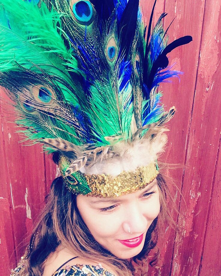 A personal favourite from my Etsy shop https://www.etsy.com/uk/listing/484442191/statement-feather-and-sequin-headdress