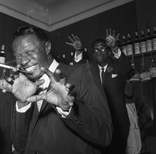 Nat King Cole and Sammy Davis Jr goofing around at the Villa Capri, 1955.  Photo by Bernie Abramson.