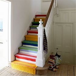 These colorful stairs were made by sewing 6 rugs together. (via bluemossgirl)