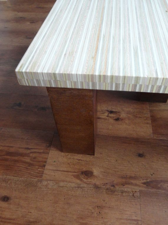 The linear patter in the table top was made by cutting strips of Birch Plywood, turning and gluing them together side by side. Beneath the top layer there is a plywood backer board to provide more stability. The legs are made with the same Birch Plywood, stained with a dark walnut color in order to contrast with the light color pattern of the table top. Size: 23.5W x 23.5L x 12H