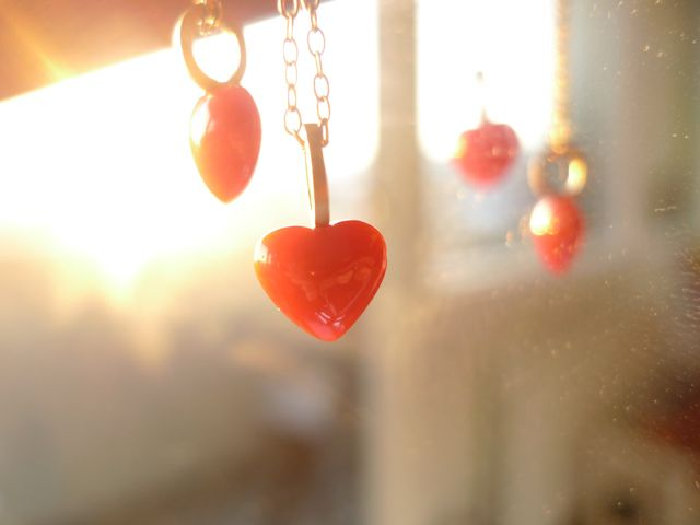 Coral hearts chained in gold. By Karina Bach-Lauritsen.
