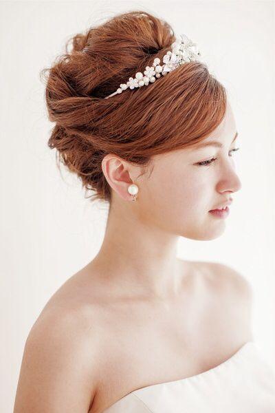 Bride hairstyle tiara updo with bang