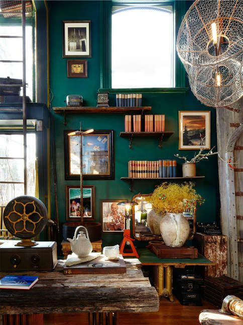 I can't resist a lovely office with bold emerald green wall color and floating shelves.