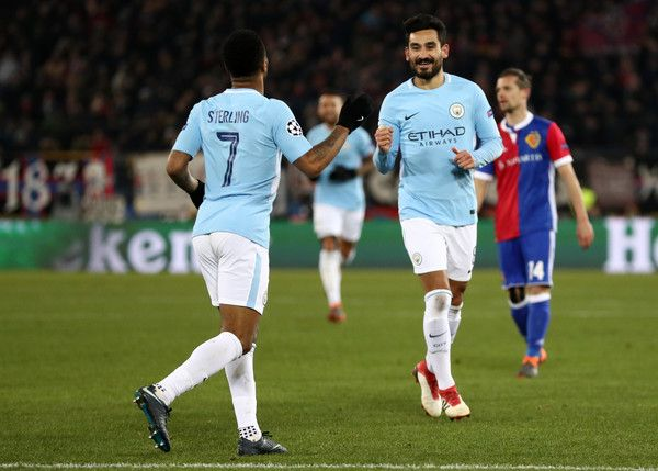Ilkay Gundogan Photos - Ilkay Gundogan of Manchester City celebrates after scoring his sides fourth goal with Raheem Sterling of Manchester City during the UEFA Champions League Round of 16 First Leg  match between FC Basel and Manchester City at St. Jakob-Park on February 13, 2018 in Basel, Switzerland. - FC Basel v Manchester City - UEFA Champions League Round of 16: First Leg