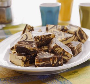Whip up this delicious #chocolate #Peanut Butter #Fudge and decorate with delicious Cadbury Chocolate Mini Finger #Biscuits. #baking To view the #CADBURY product featured in this recipe visit https://www.cadburykitchen.com.au/products/view/baking-block/