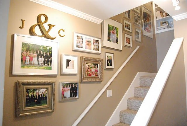 cute stairway gallery wall...love the monogram