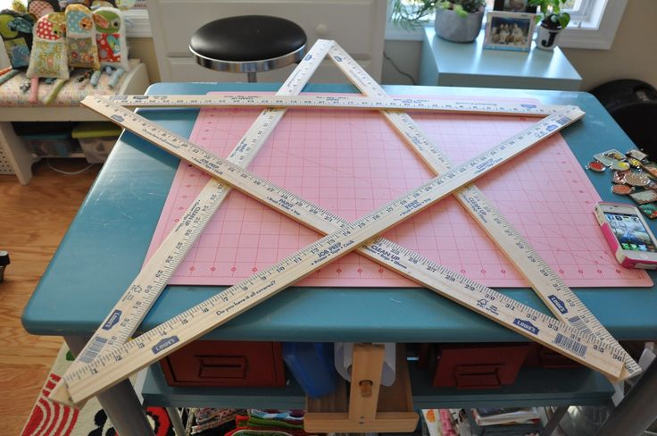 "a giant yardstick star...  ""All I did for assembly was to lay them out in a star shape, fiddle with them until they were ""right"" and hot glue all the placed they touched with generous amounts of hot glue."""