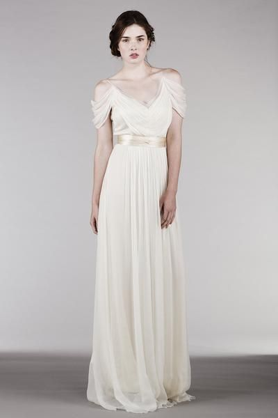 """This romantic, sheer V-neck dress is a reinvention of one of our classic favorite styles. The added drama, with ever so softly dropped shoulders, is in perfect harmony with the flowiness of the dress for truly effortless elegance. Made of 100% silk: • Top layer: Off white silk chiffon. • Lining: Cream silk charmeuse. • The dress comes with 2"""" eggshell satin sash. • Should be worn with a regular strapless bra. ***Sizes 4, 8, 10, 12 & 14 are currently sold out. If you would like to place..."""