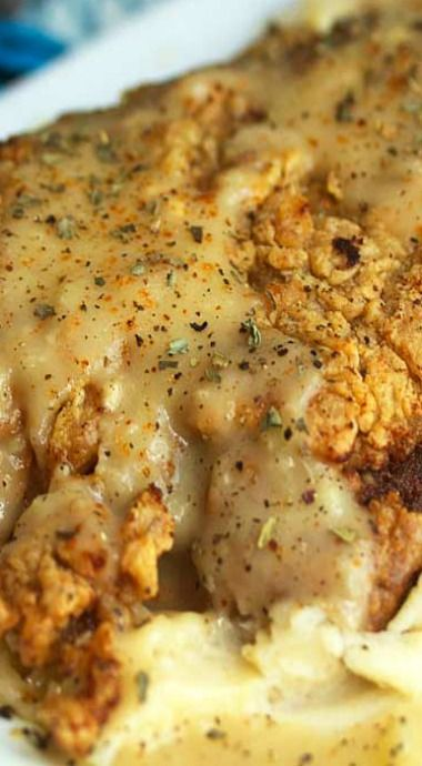 Chicken Fried Steak ~ The steak is tender and well seasoned with a perfectly golden brown crispy crust. The gravy is yummy too with its bits of onion, garlic, and spice.