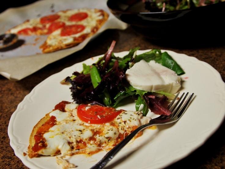 Thin Crust Tomato Basil Pizza w/ fresh mozzerella & feta cheese.