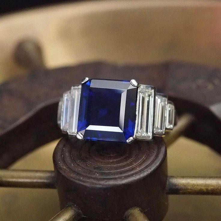 By request, another peek at the Art Deco 5.75ct unheated Pailin sapphire ring of our dreams. How timeless and sleek is the bezel set baguette setting? DM for details #jogani #joganibh ⠀ ⠀ 5.75ct Emerald Cut Pailin Sapphire No Heat Gubelin AGL⠀ ⠀ #sapphire #bluesapphire #giacertified #raregem #gemstone #coloredstones #finejewelry #antique #antiquering #antiquejewelry #showmeyourrings #deco #artdeco #artdecojewelry #estatejewelry