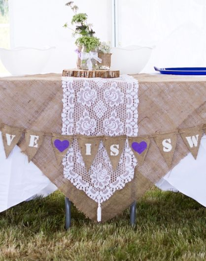 They had white table clothes, then made an overlay from burlap with a lace runner and hung a bunting across the front for the head table (it says love is sweet ... so this may be the dessert table, not sure).