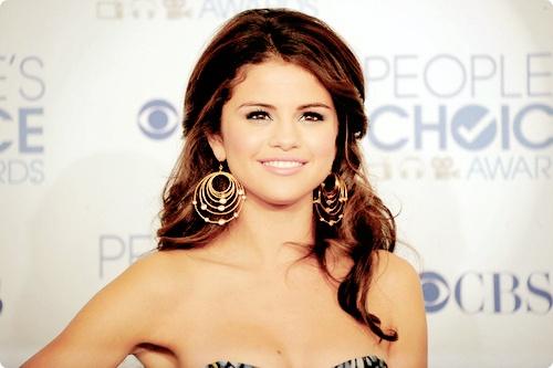 Selena Gomez http://www.fineofjewelry.com/14k-yellow-gold-emerald-and-diamond-jhoop-earrings.html