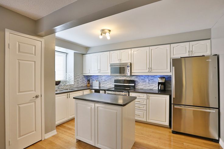 Making your kitchen sparkle with WHITE cabinets!