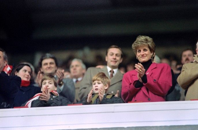 Diana, Princess of Wales, (R), Princes William (L) and Harry applaud during the Wales vs France Five Nations Cup match at Cardiff Arms Park on February 1, 1992.