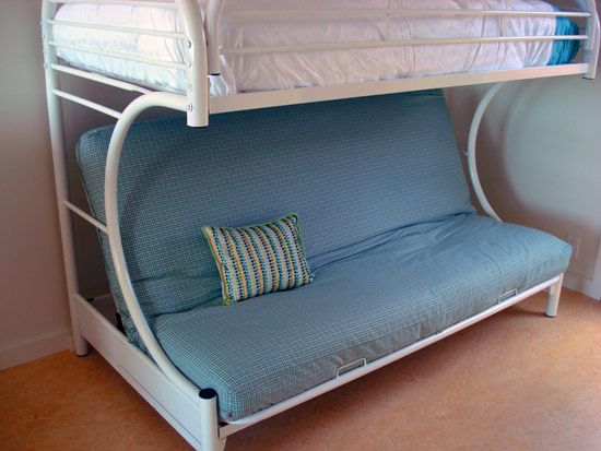 creative white metal curved bunk bed with pillowy blue upholstered couch