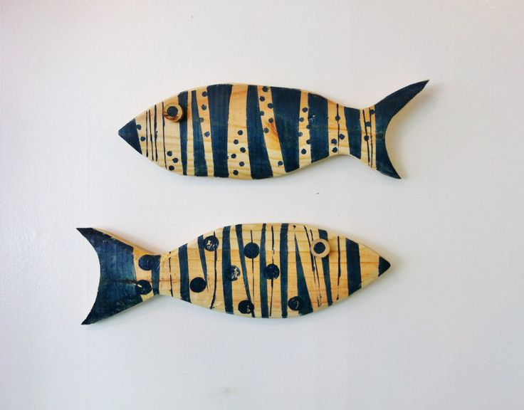 Teal-stained recycled wooden fish.