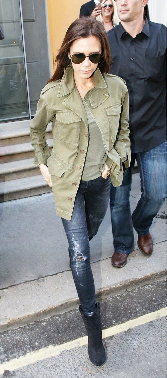 Victoria Beckham casually wearing a military coat and jeans.