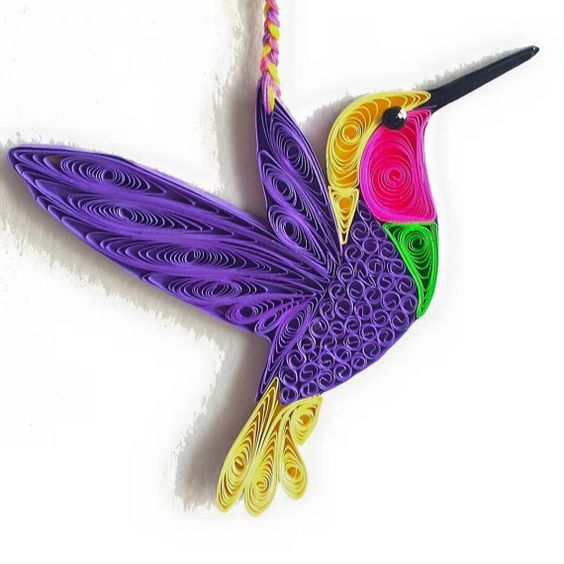 Paper Quilled Hummingbirds These are paper quilled Hummingbirds. Size: 4x4 inches (approx.) Material used: 1/8 inches paper strips, colorful: