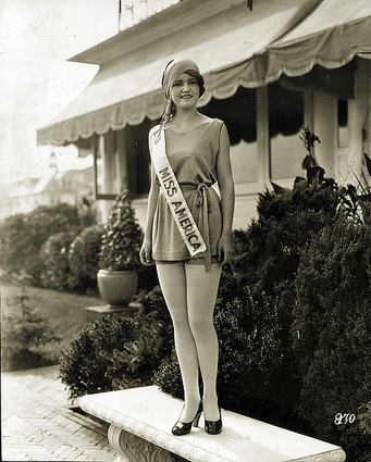 "1927: The first Miss America from Illinois was the one who kept the title the longest, from 1927 to 1933. Her extended reign had less to do with her ""pulchritude"" (a word that turns up a lot in old Miss America news stories) than with the pageant's cancellation due to complaints that the contestants not only exposed their flesh but also wanted some compensation for participating. But Lois Delander, who was only 16, just wanted to finish high school. She did, later married and lived in…"