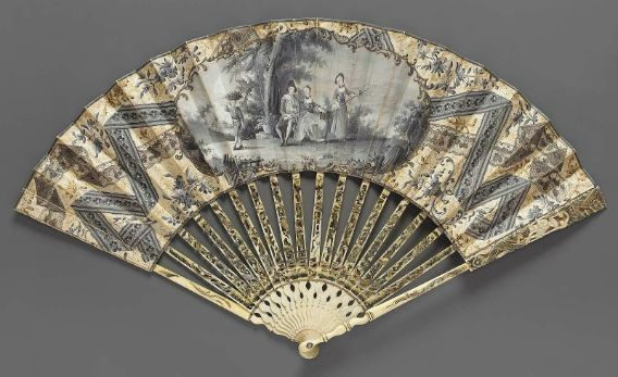 """Mourning fan,  French, 1755–65. Printed and hand-colored paper leaf primarily in shades of gray. Obverse: woman with """"fortune-telling bird"""" cage and man seated in park, standing woman and boy with basket on head, gilt and black scrollwork border; painted ribbon and lace designs among floral details. Reverse: simple landscape, floral border. Narrow gray band at top. Carved and pierced ivory sticks with gilt and black painted details; man on guards. Diamond paste studs in rivet."""