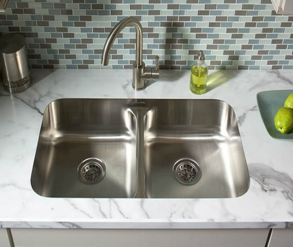 """And did you know that you can even use undermount sinks with Formica now, too? Check it out…Love this for not only """"real factor"""" but easier to clean crumbs and """"gunk"""" that accumulates on counter-top, nothing to get trapped in edges. LOVE the shiny stainless steal sink too!!"""