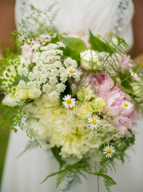 A stunning garden style wedding bouquet with gorgeous peonies.