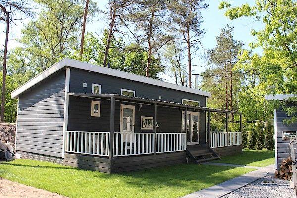 Sfeervol 8 persoons vakantie huisje te huur in het bos. Gelegen op de Veluwe op een kindvriendelijk recreatiepark met vele faciliteiten.