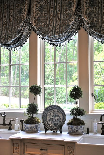 Really loving these kitchen window treatments.