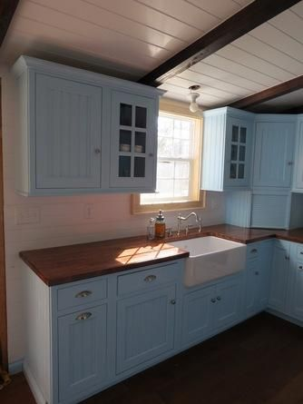 These readers opted for powder blue cabinets warmed up by IKEA-sourced butcher block countertops in their country kitchen redo. | thisoldhouse.com/yourTOH