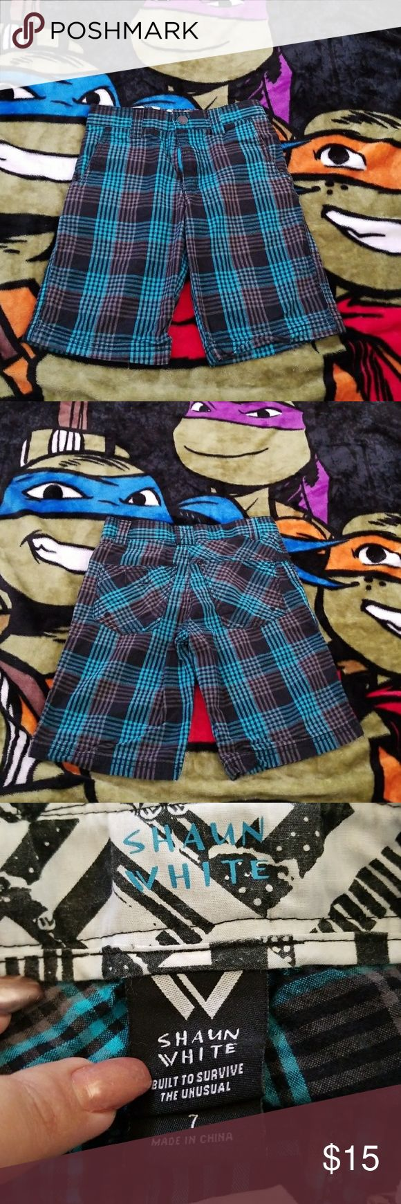 Boys Size 7 Shaun White black & blue plaid shorts Boys Size 7 Shaun White black & bright blue plaid shorts with adjustable waist. Comfortable & lightweight 100% cotton. Used but in excellent condition. Shaun White Bottoms Shorts