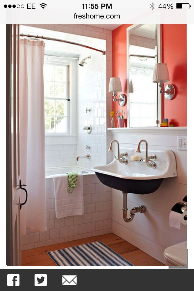 love this small bathroom hate the coral wall paint window by showertub curvy silver faucets at sink white tile showertub