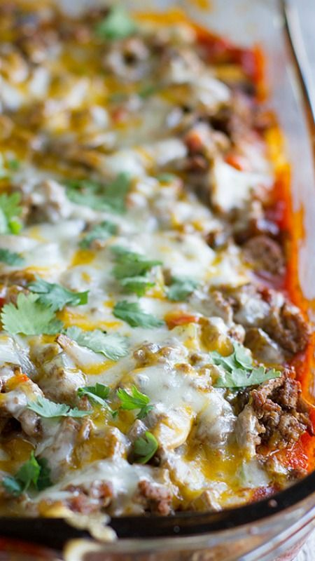 Taco Casserole ~ Biscuits are coated in taco sauce then topped with spiced ground beef and lots of cheese
