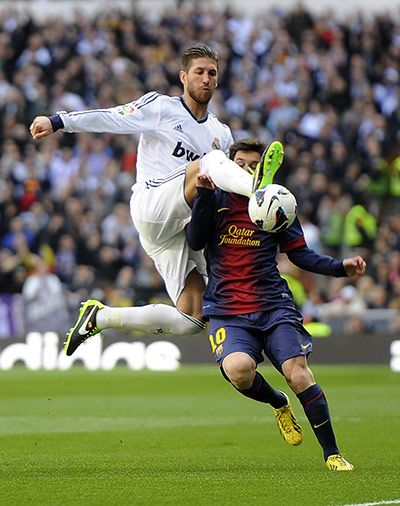 Sergio Ramos clears from Lionel Messi. Camille we will be rooting for opposing teams