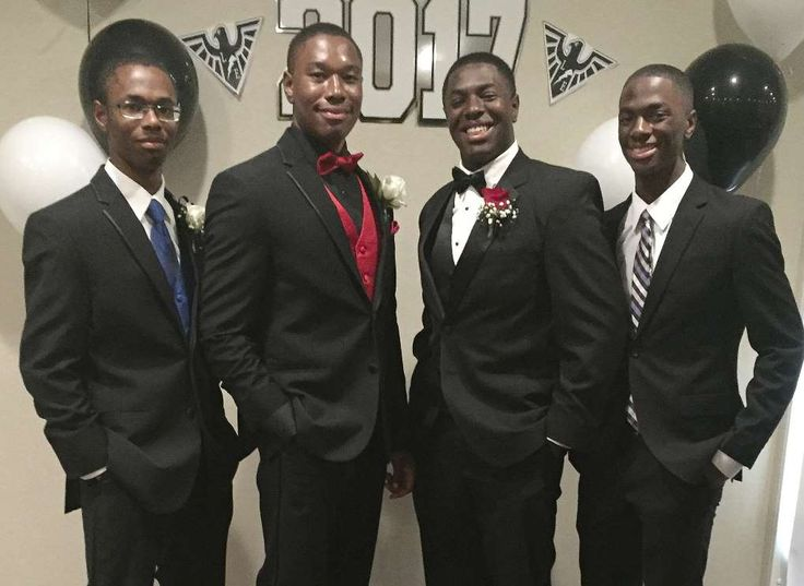 This April 22, 2017 photo provided by Kim Wade, shows her quadruplet sons from left: Nigel, Zachary, Nicholas, and Aaron Wade in Liberty Township, Ohio. The quadruplets will be the second set quads to attend Yale University in New Haven, Conn., since 2010, (Kim Wade via AP)