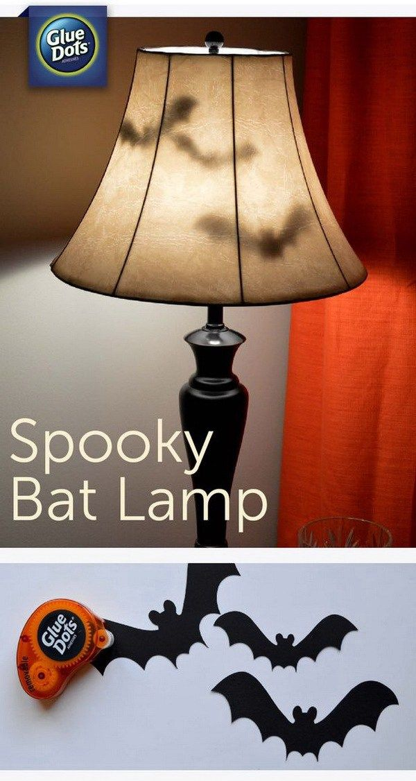 Spooky Bat Lamp. Make your home a little extra spooky and add a fun addition to your bedroom this Halloween season with paper bats and removable glue dots.