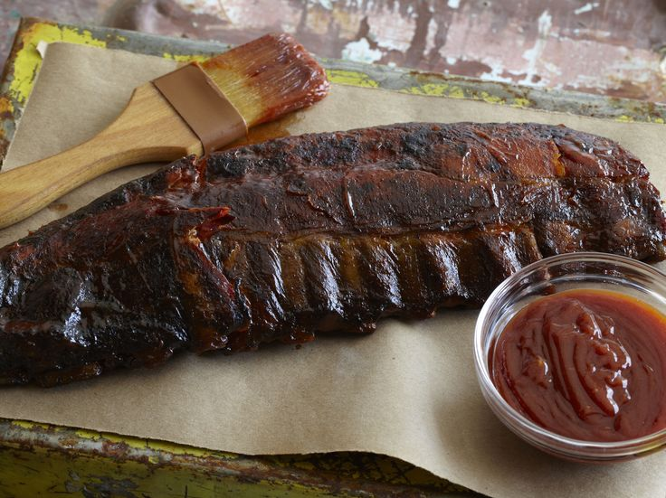 The Ultimate Barbecued Ribs : Barbecuing ribs at home can be as easy-breezy as the summer season itself. With these simple instructions, prepare a rack of smoky ribs with homemade barbecue sauce that will rival your favorite barbecue joint's.  via Food Network